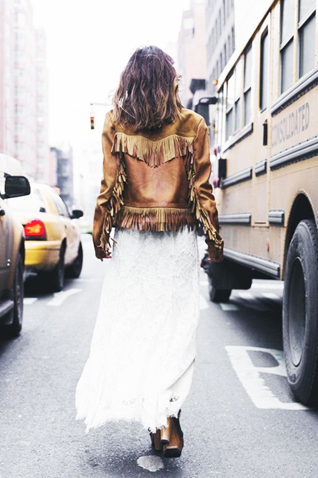 When in doubt, a leather jacket (with a healthy serving of fringe) worn over a long dress makes for a bold statement.