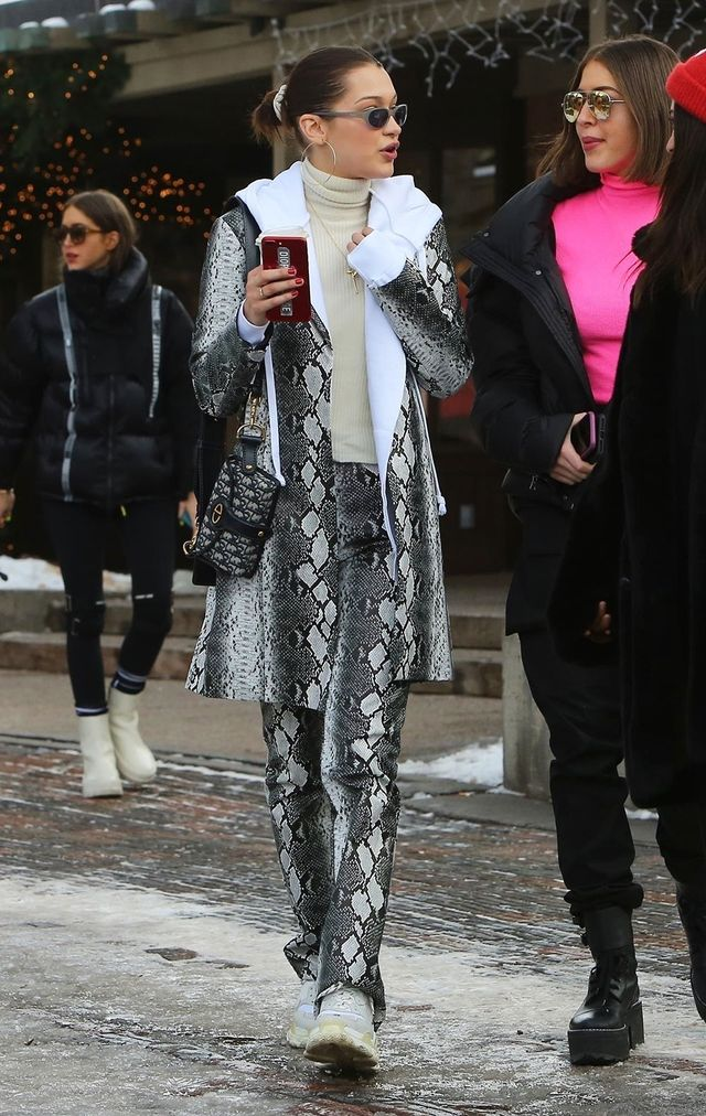 On Bella Hadid: Luv AJ XL Capri Wire Hoops ($40); I.Am.Gia Brandy Jacket($100) and Brandy Pant ($92); Dior Small Dior Oblique Flap Bag (available in-store); Balenciaga Triple S Trainers...