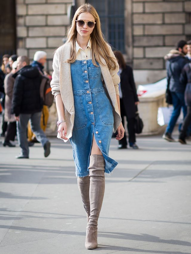 Dress up the casual denim look with a structured blazer and tall boots.