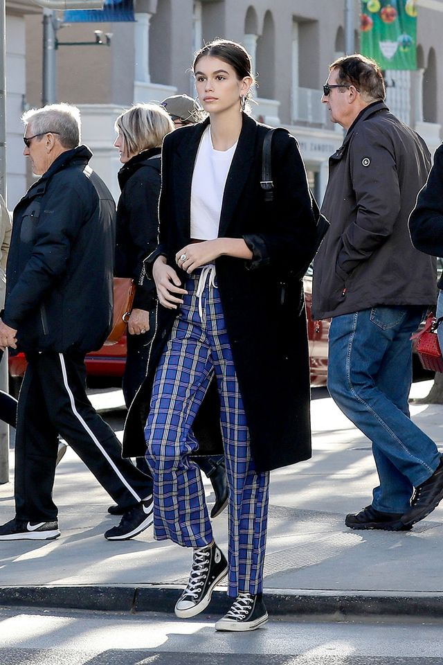 Kaia Gerber wearing plaid pants and converse