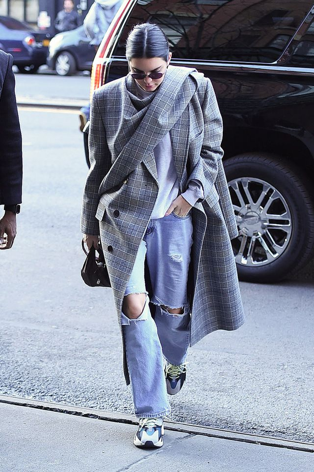 Kendall Jenner wearing plaid coat and yeezy sneakers