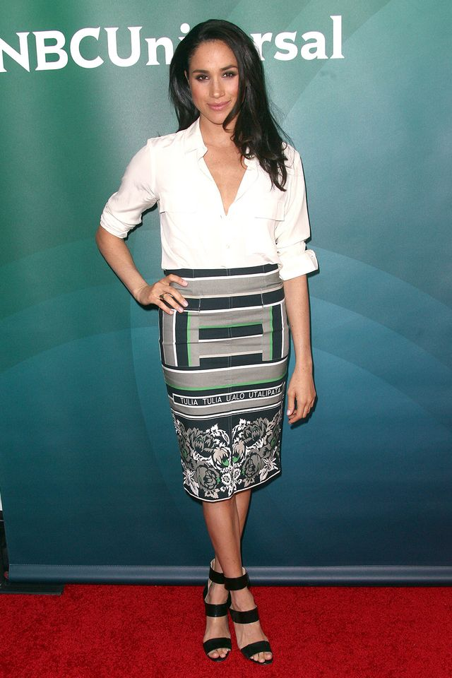 As Markle proves here, you can't go wrong with a simple white blouse and printed skirt.