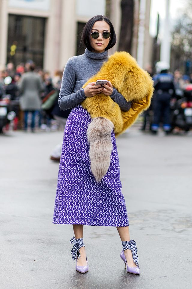 Tuck a sweater into a high-waisted skirt for a polished look.