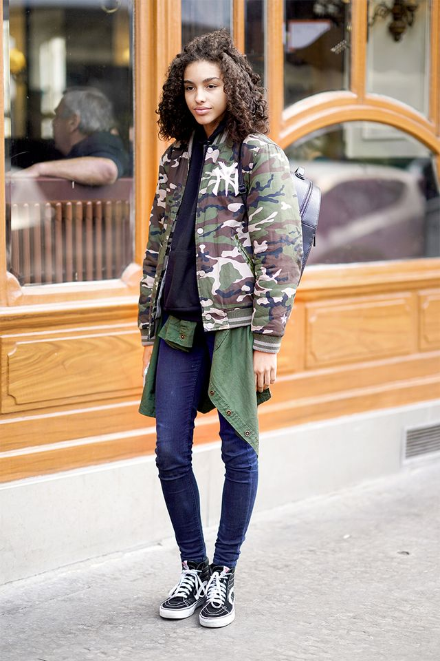 Throw a bomber version over jeans.