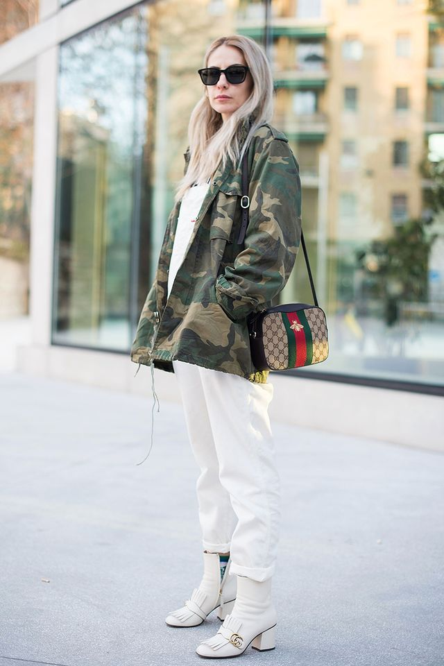 Layer your camo jacket over an all-white outfit.