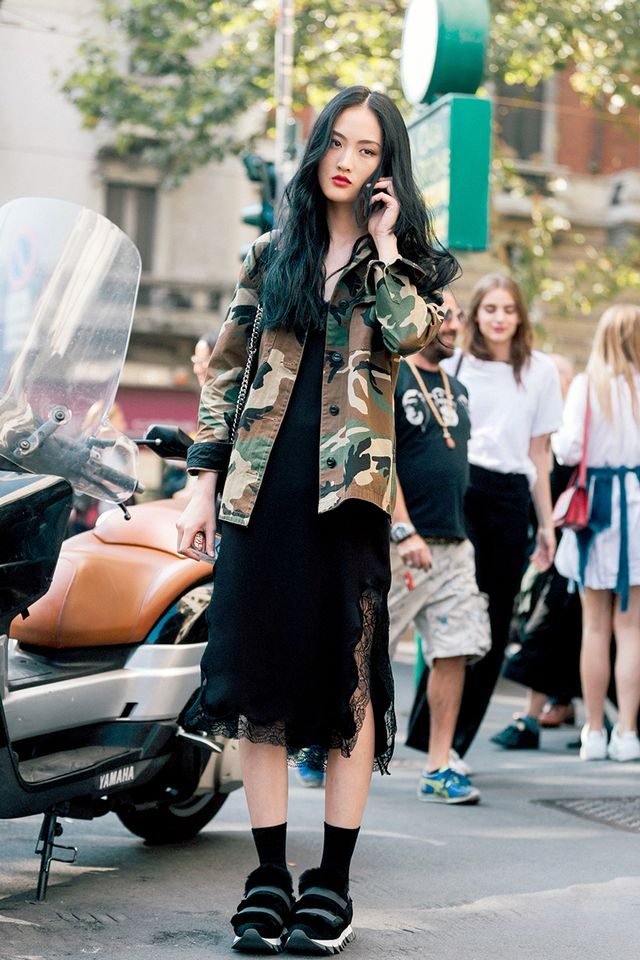 Add a cool spin to your slip dress with a camo jacket. Next,shop 18 affordable handbags that look expensive.