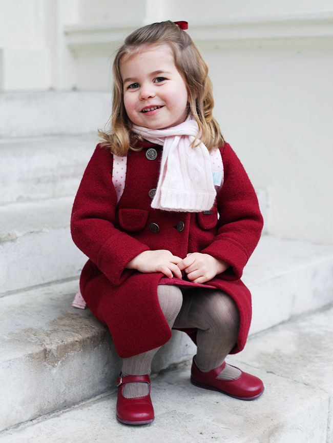 Princess Charlotte wearing an Amaia red coat, red Dona Carmen shoes, pink Marie Chantal scarf and Cath Kidston backpack for her first day at nursery