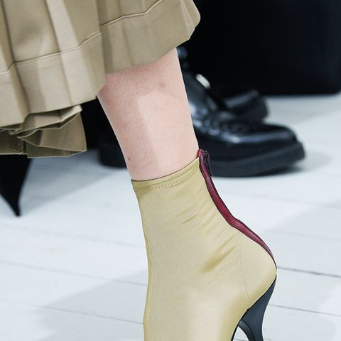 shoe trends 2018: curvy-heel boots at Celine