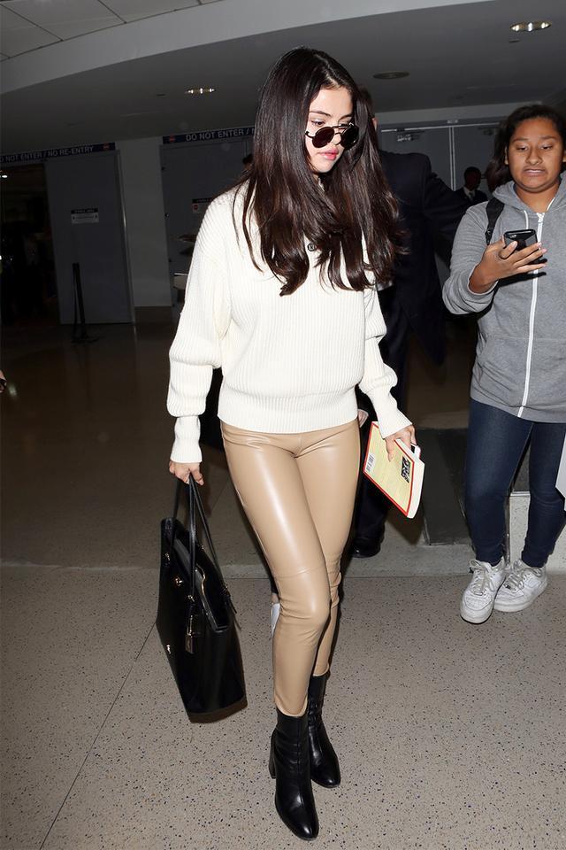 Selena Gomez tan leather leggings, black boots