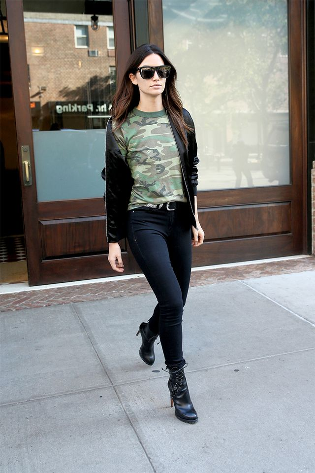 Lily Aldridge wearing camo top ankle boots