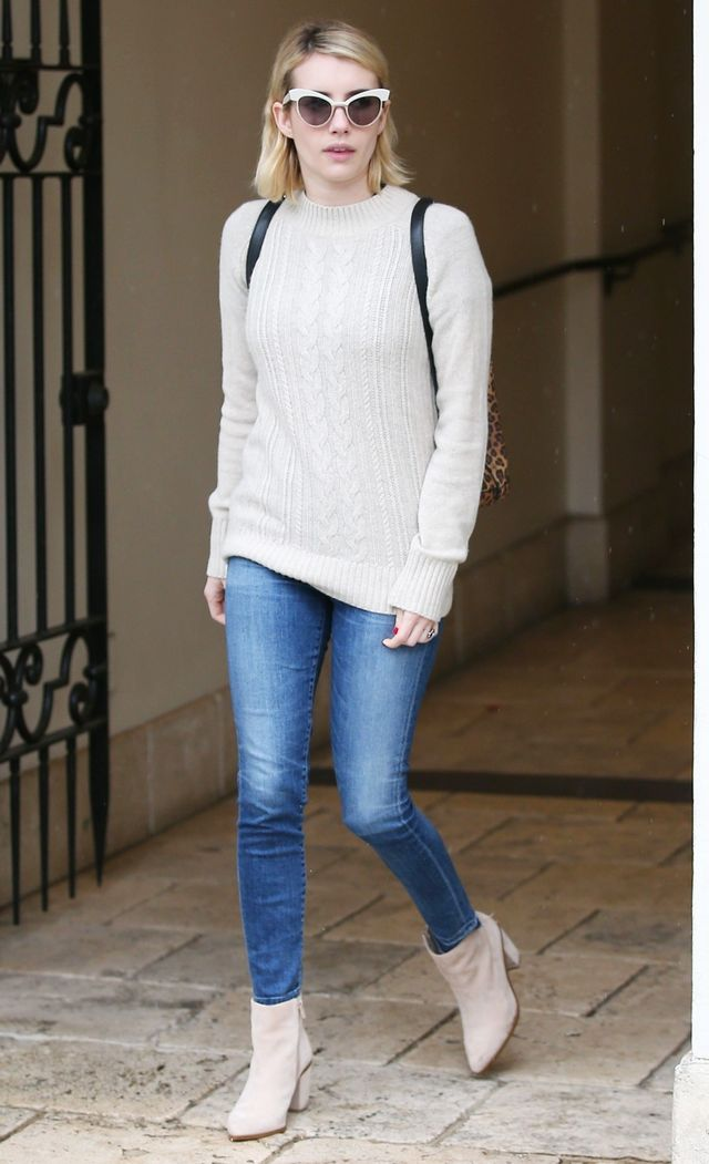On Emma Roberts: AG sweater; Citizens of Humanity High Waist Crop Skinny Jeans ($218); 1.State Paven Pointy Toe Booties ($70)