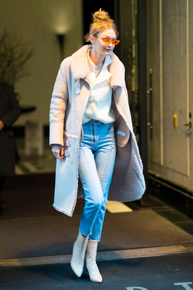 On Gigi Hadid: Poppy Lissiman Le Skinny Sunglasses ($98); Kith x Iro Barki Shearling Parka ($2495); Stuart Weitzman The Clingy Booties ($575)