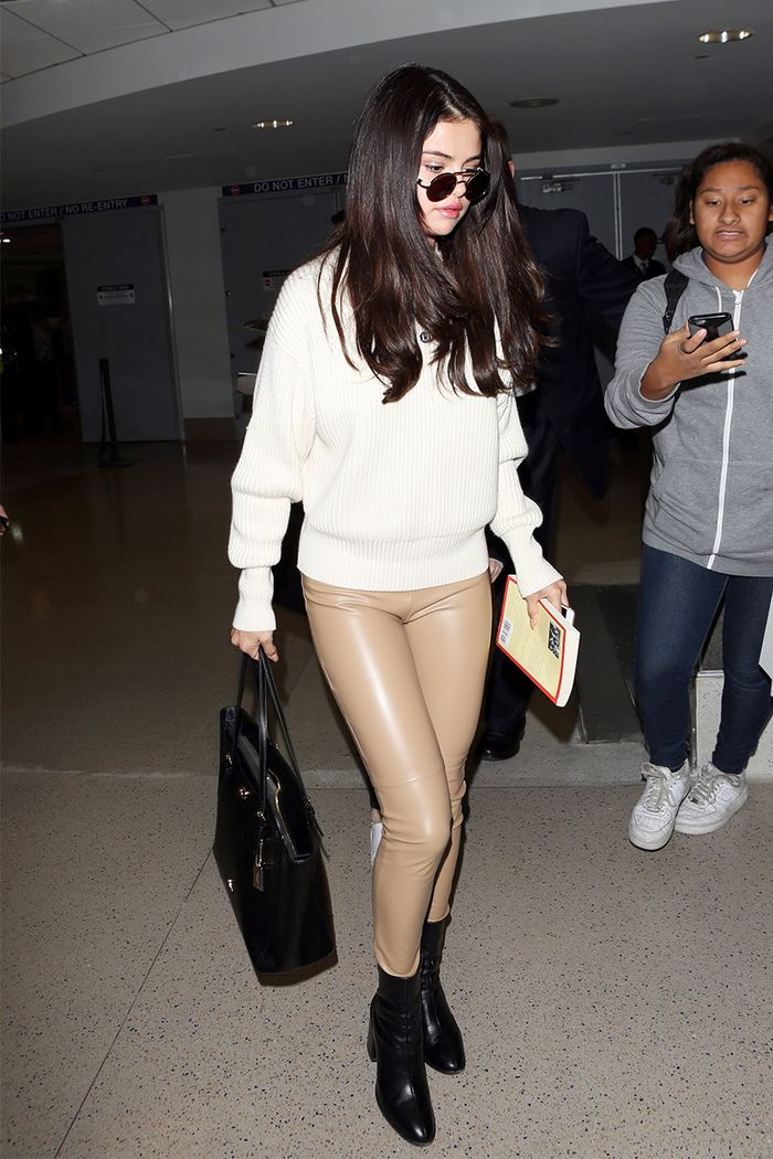 Selena Gomez tan leather leggings, black boots