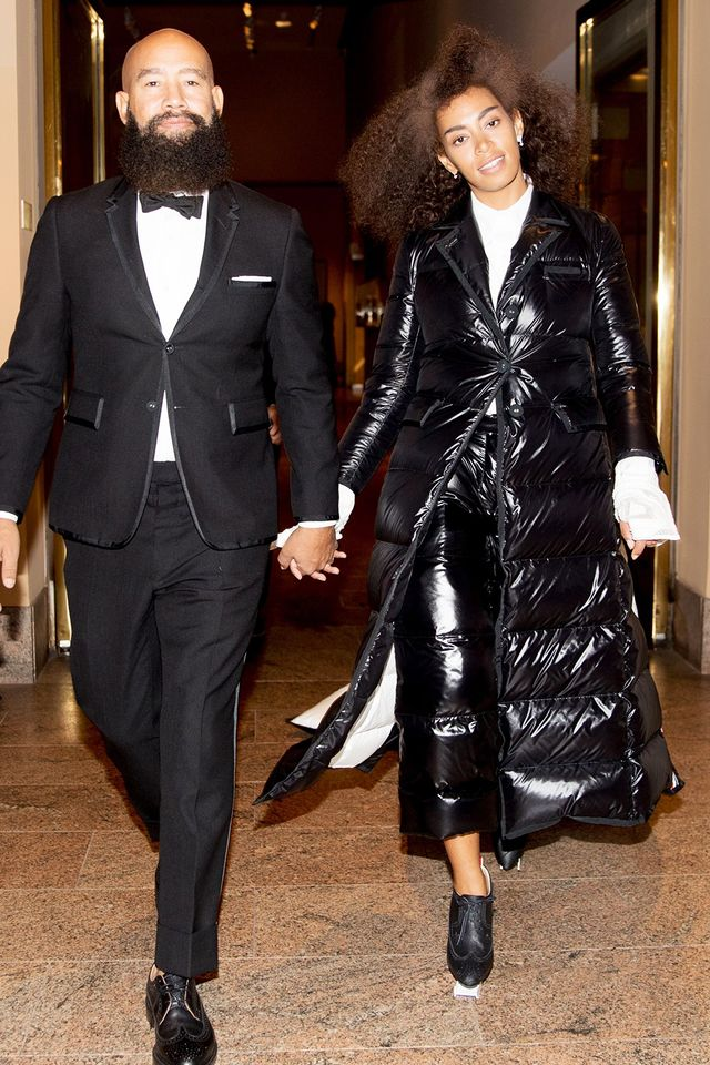 Solange and husband Alan Ferguson's outfits weren't quite the literal interpretation of matching you'd expect. Instead, their oxford shoes and black-and-white suiting separates were a...