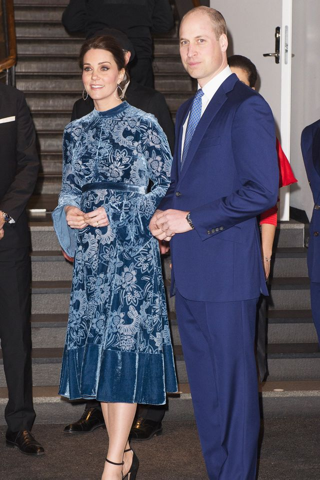 No one does matching outfits quite like this royal couple. Kate Middleton's blue velvet dress complements Prince William's suit to a T. Well done, Kate and William.
