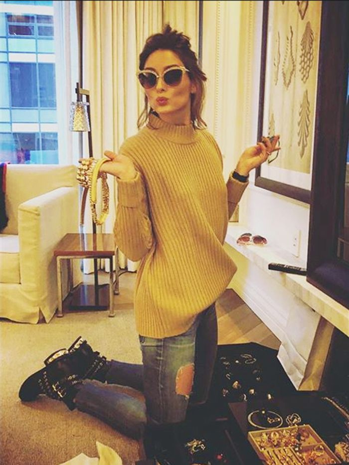 Olivia Palermo wearing a mustard jumper and ripped skinny jeans