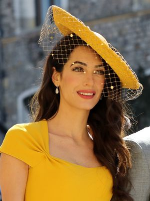 Amal Just Joined a Long and Iconic List of Celebrities in Yellow Dresses