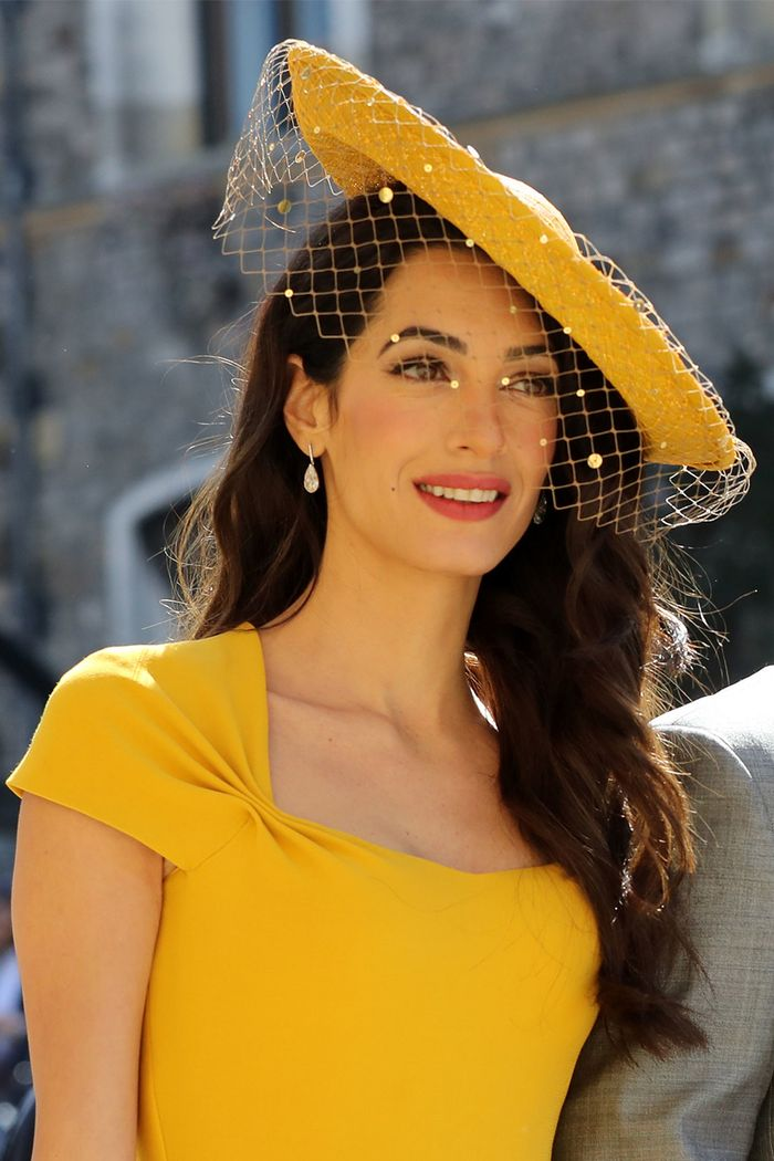 Amal Clooney wearing a yellow Stella McCartney dress to Harry and Meghan's royal wedding in 2018