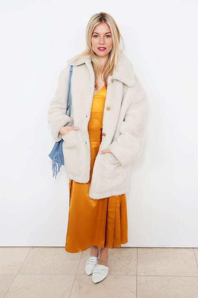 WHO: Sienna Miller WHAT: Tory Bruch F/W 18  WEAR: Tory Burch coat and dress