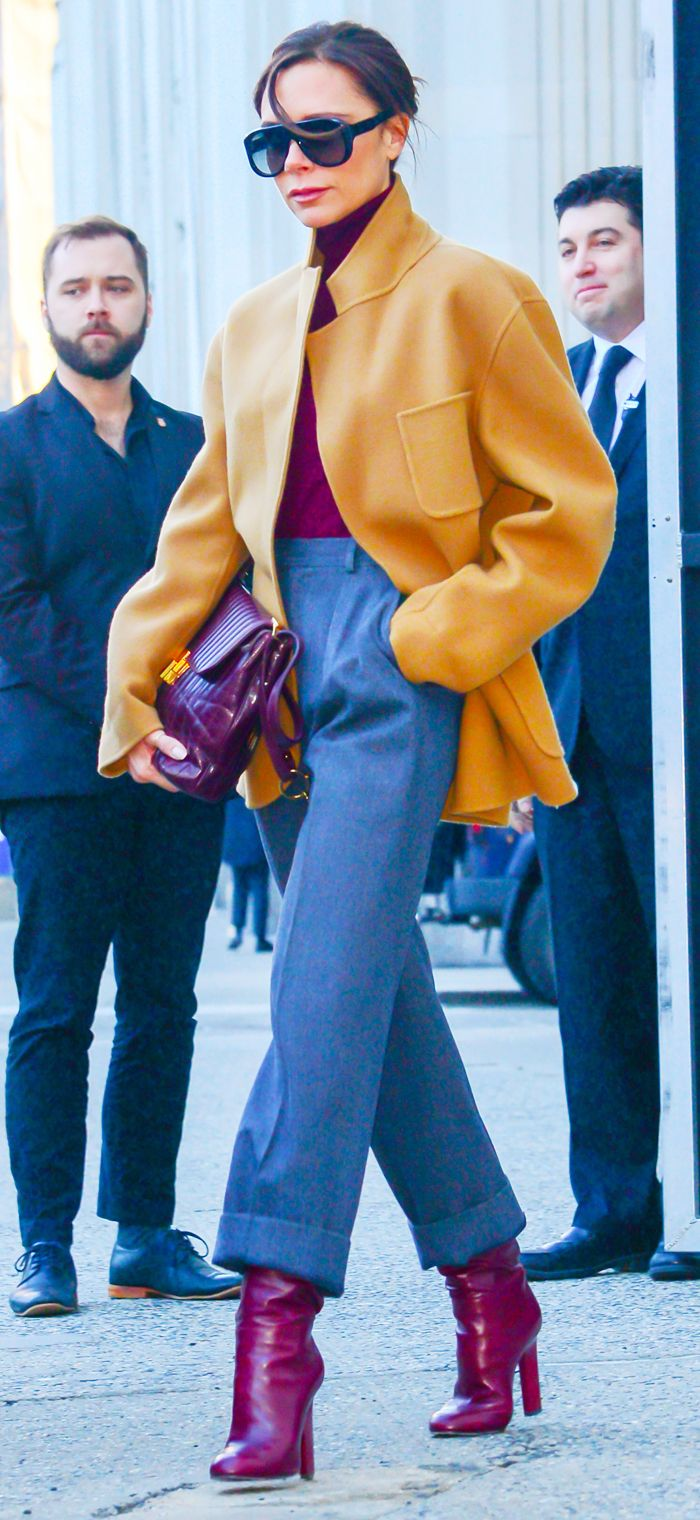 Victoria Beckham tan jacket and red boots