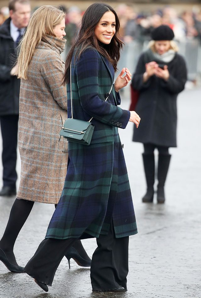 On Meghan Markle: Burberry Double-Breasted Tartan Wool and Cashmere-Blend Coat ($2895); Strathberry East/West Mini Bag in Bottle Green ($545); Wolford Colorado Turtleneck...