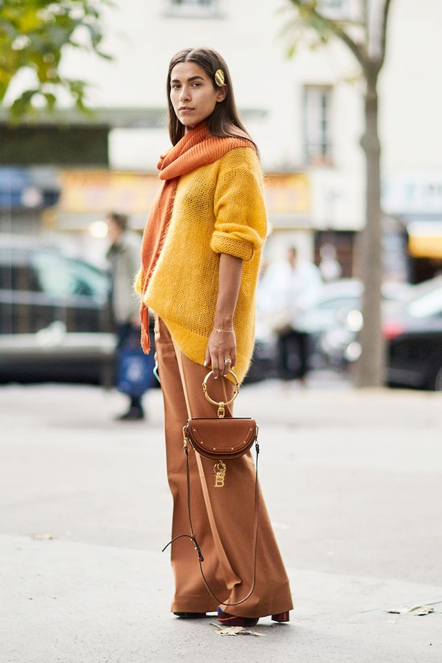 Monochrome doesn't always have to mean an outfit of (literally) all the same color. Warm shades of brown, yellow, and burnt orange come together effortlessly in this look, illustrating how to...