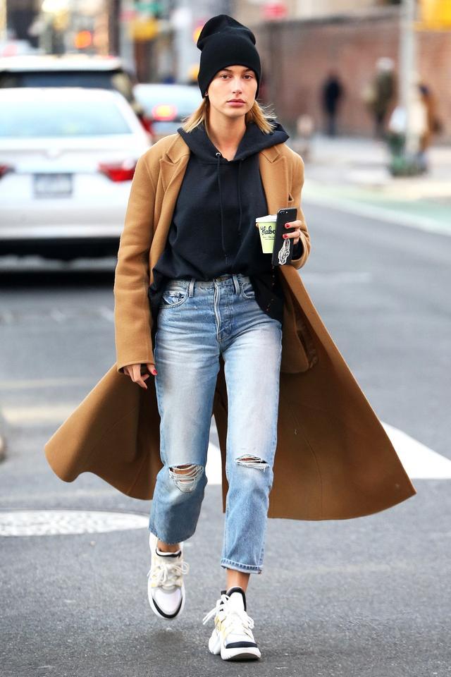 On Hailey Baldwin:Anine BingShane Cashmere Beanie ($89); Louis Vuitton Archlight sneakers; Victoria Beckham coat