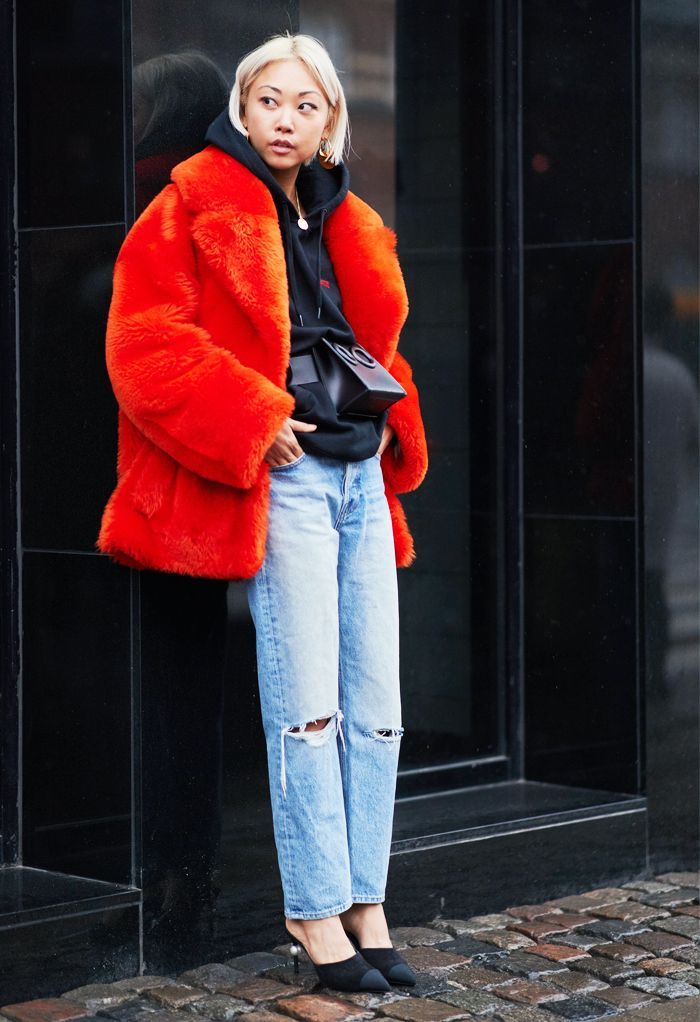 How to rip jeans: Street Style at Copenhagen Fashion Week of jeans with knee rips