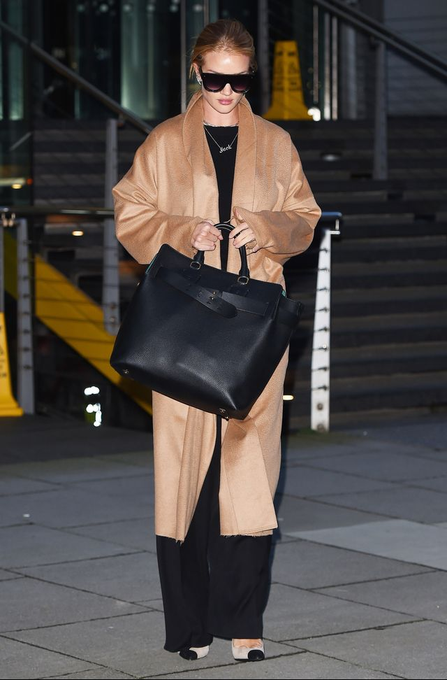 On Rosie Huntington-Whiteley: Nili Lotan coat;Isabel Maranttrousers;Saint LaurentAnja Two-Tone Suede Pumps ($695); Burberry LargeLeather Belt Bag ($2590)