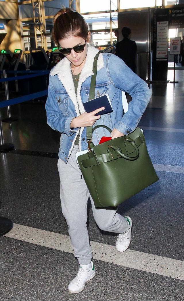 On Kate Mara:LoftFleece Lined Denim Jacket($100); Adidas OriginalsStan Smith Sneakers ($75); BurberryMedium Leather Belt Bag ($2290)