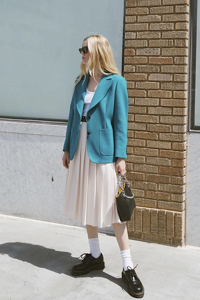 Spring outfit ideas: Megan Adelaide wearing blazer and midi skirt