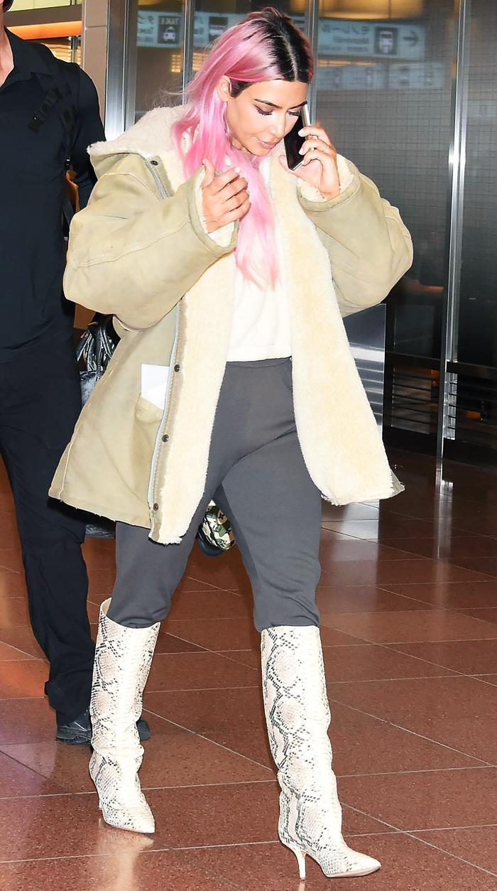 Km Kardashian West: snakeskin boots