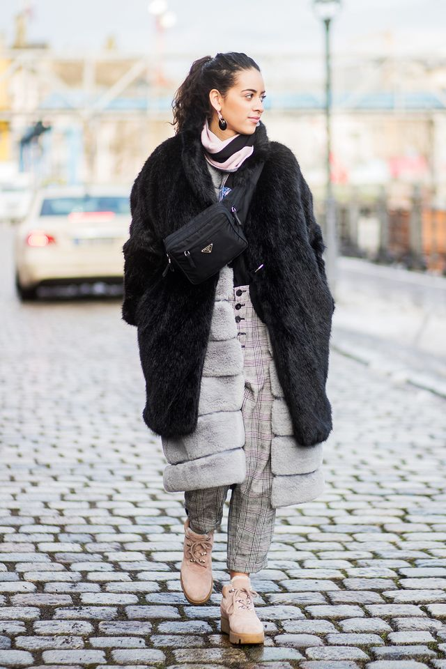 If you've ever traveled to Berlin, you'd know just how cold the city really gets. Enter not one but two (!) furry coats. The layered look makes a cool statement and is honestly downright practical...