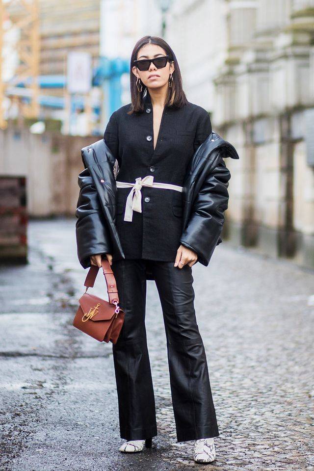 There's nothing boring about this sleekall-black look. The play on textureshere adds interest to the monochrome while a contrasting belt is eye-catching.