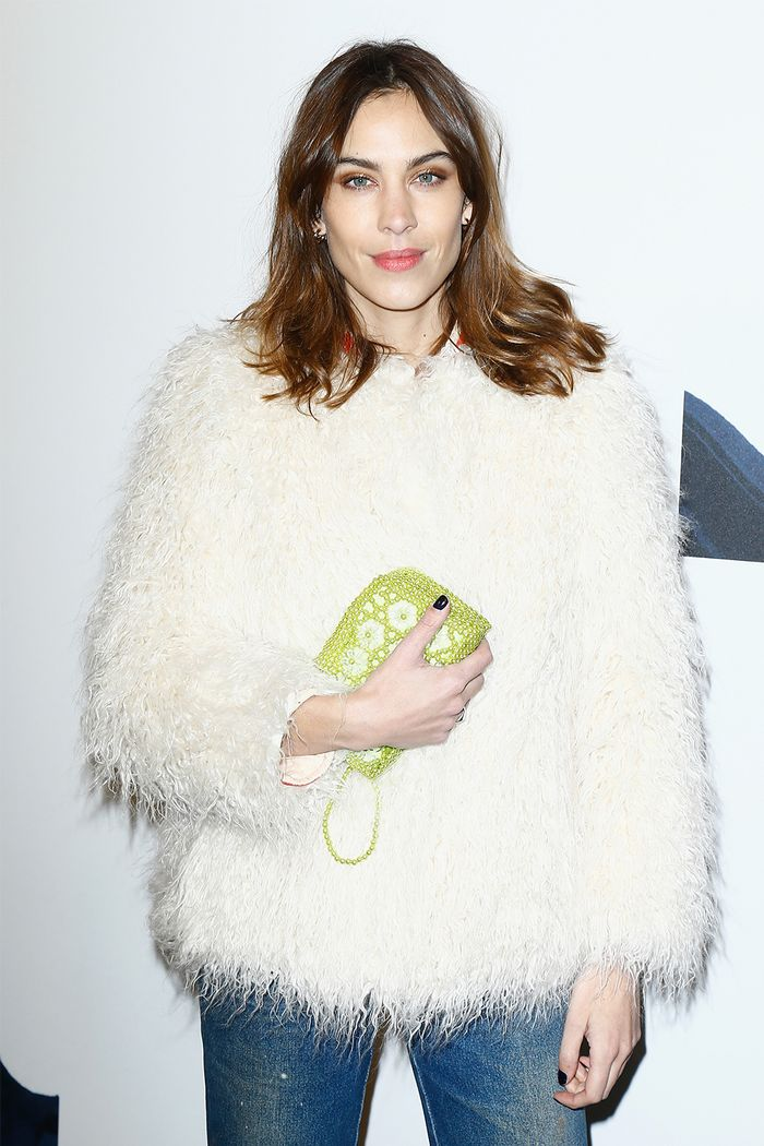 Alexa Chung at the H&M show wearing a faux fur coat and jeans