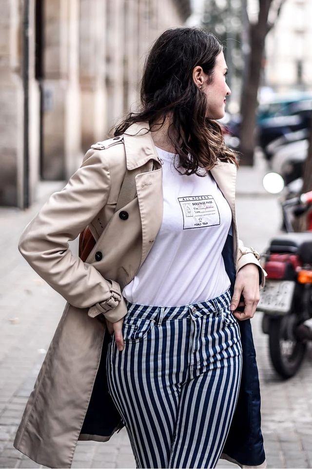 We love the look of a graphic tee and striped jeans that resemble pinstripes.