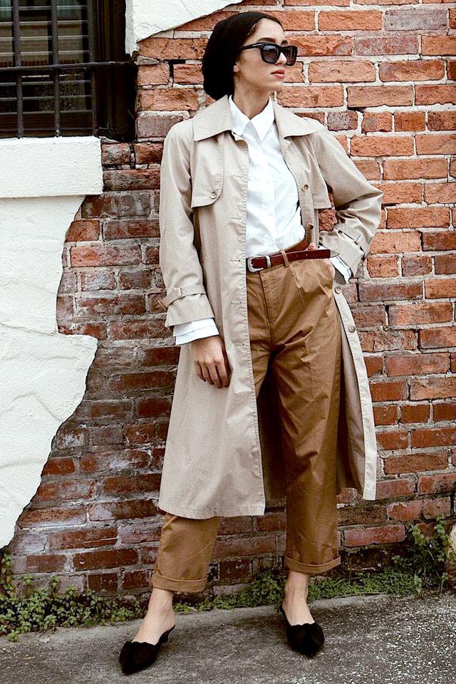 Wear menswear staplesto play up the trench coat's subtle Sherlock Holmes vibe.
