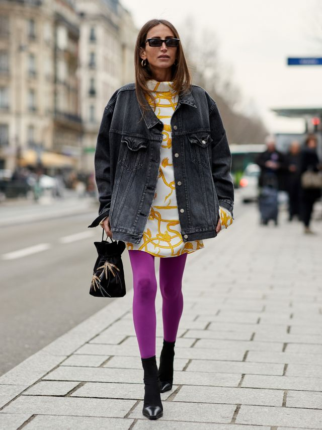 Swap out your standard black tights for a pair of bright purple ones to give your look that extra punch.