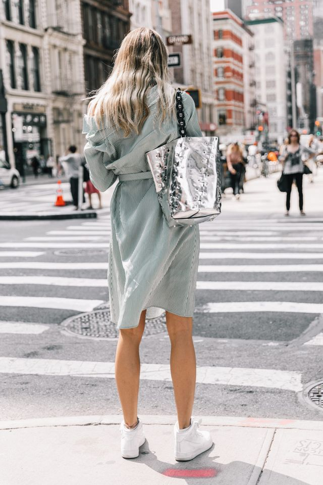 Striped dress with silver bag