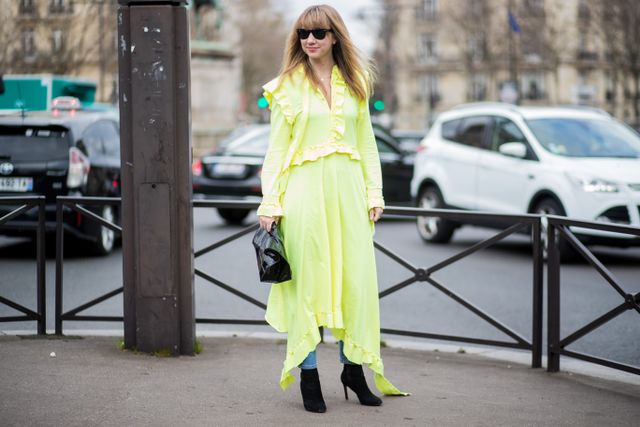 Yes, you can wear jeans under a dress.