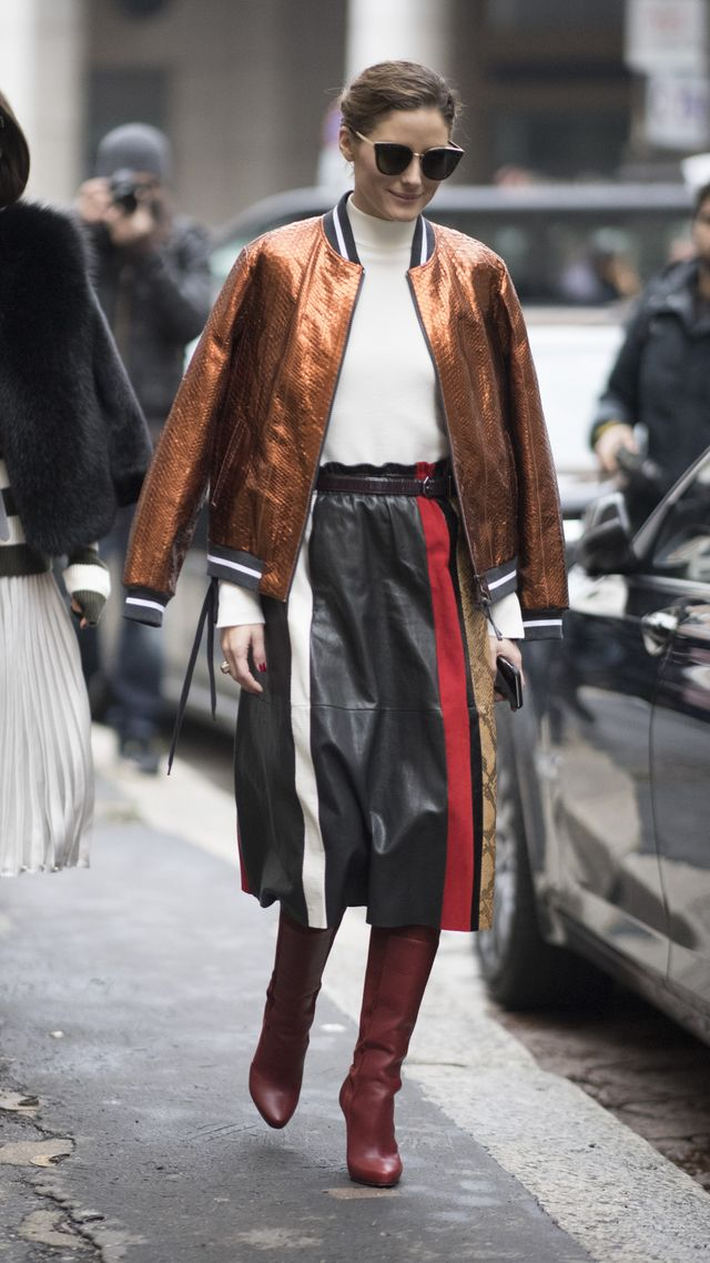 Pair a midi skirt with tall boots so that none of your legs are exposed to the chilly weather.