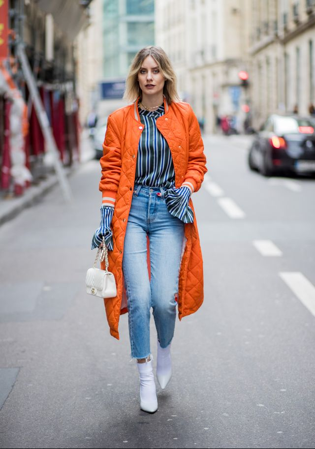 Tick off two trends with one outfit by pairing a bright coat with white ankle boots.