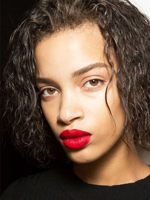If You're Going to Wear Bold Lipstick, Don't Skip This Makeup Item
