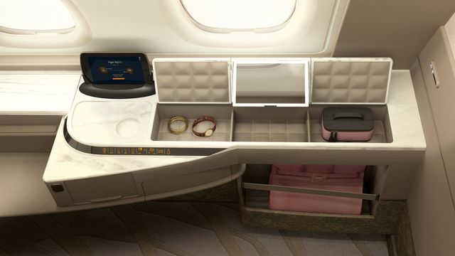 Each suite features storage compartments and a 32-inch entertainment display.