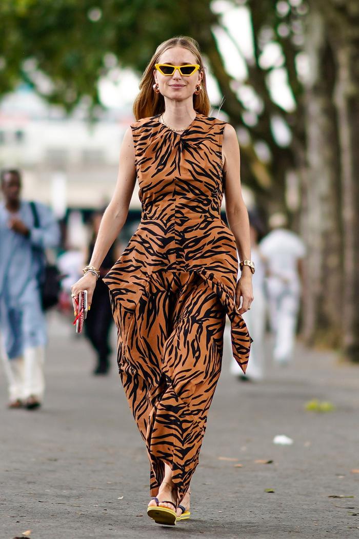 best flip flops for women: Pernille Teisbaek wearing flip flops and tiger print dress
