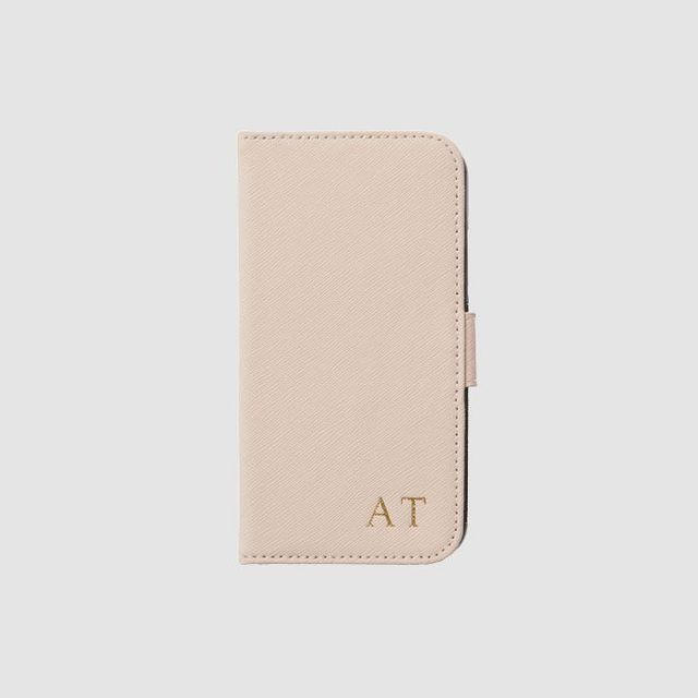 The Daily Edited Pale Pink iPhone X Flip Case