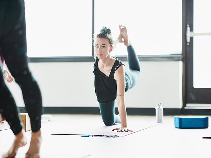These 7 Benefits of Hot Yoga Will Inspire You to Get Back on Your Mat
