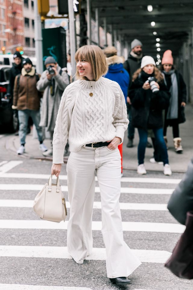 Break up an all-white look with a classic black leather belt.