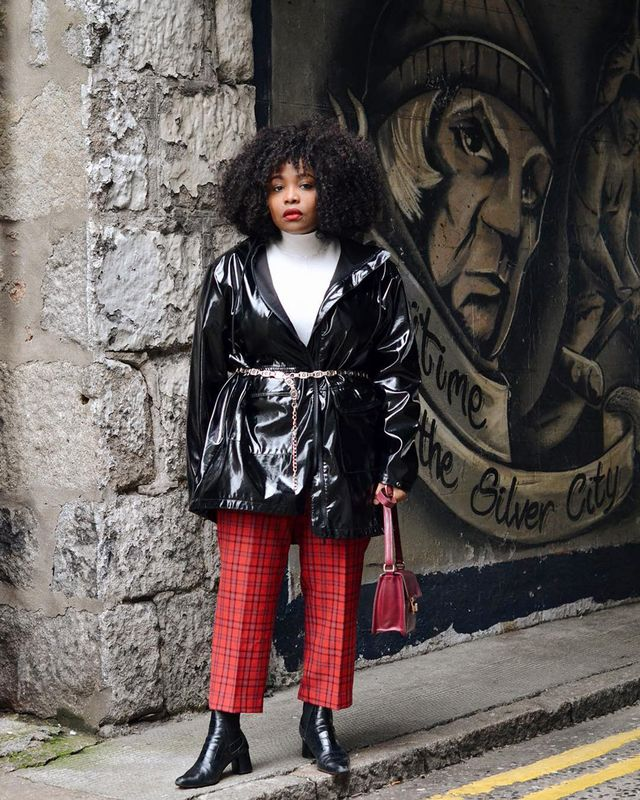 Chain belts are having a moment right now—use yours to play up the grunge element of red plaid and vinyl pieces.