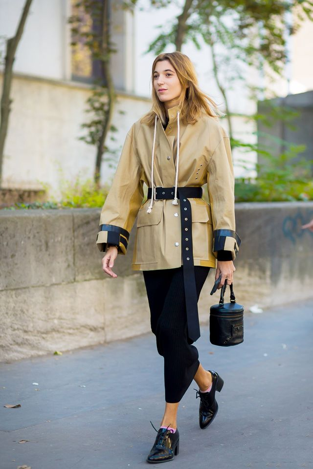 Fashion people are opting for an extra-long belt right now.